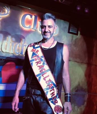 Udi Taurus onstage winning contest as Mr. Israel Leather 2018
